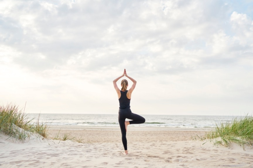 young-woman-doing-yoga-on-the-beach-picture-id1129177104 The Role B12 Injections Play in Weight Loss