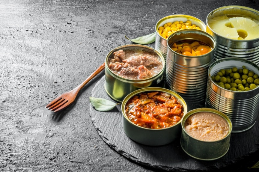 various-open-tin-cans-of-canned-food-on-a-stone-board-with-a-fork-picture-id1155944924 Non-Perishable Food List