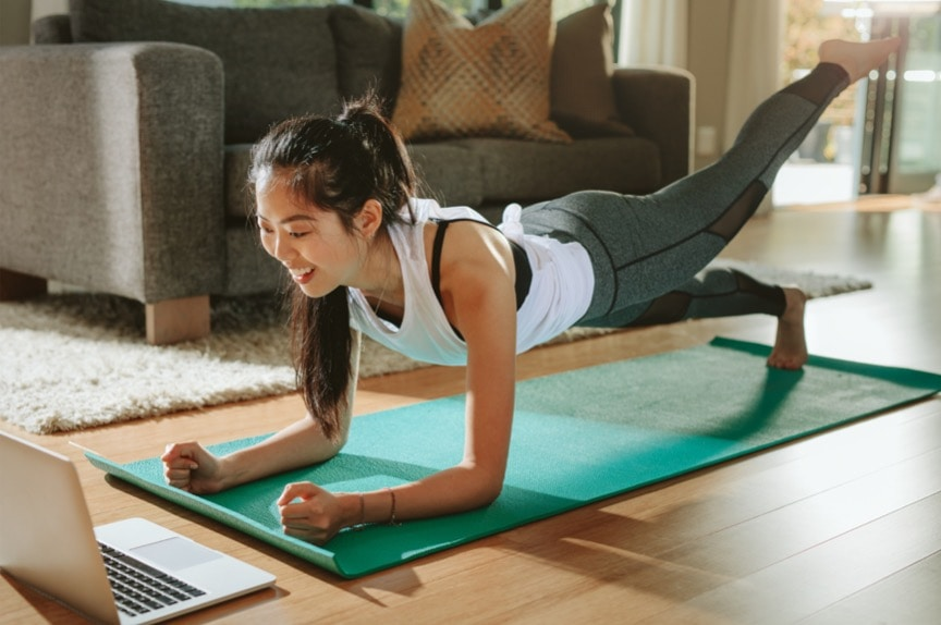 woman-watching-sports-training-online-on-laptop-picture-id1098382614 Effective At-Home Workouts